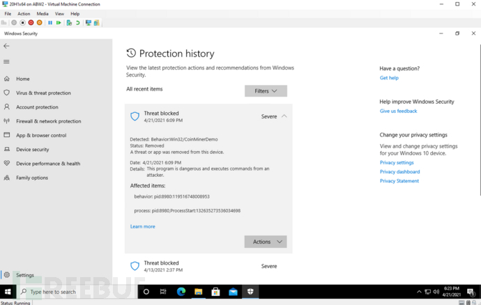 Screenshot of the Windows Security protection history screen showing that a coinminer threat was blocked by Intel TDT and Microsoft Defender.